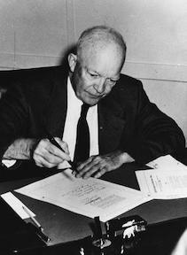 September 9, 1957 - Dwight D. Eisenhower signs the Civil Rights Act of 1957 in his office at the naval base in Newport, Rhode Island.