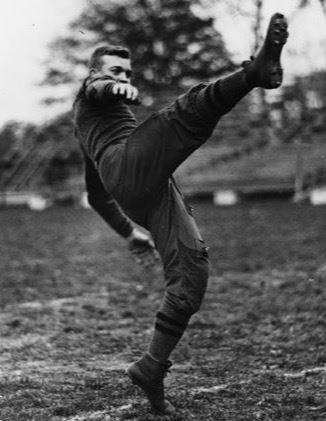 Ike punting for West Point football team